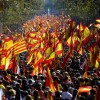 Protesters wave Spanish and Catalan Senyera flags during a pro-unity demonstration in Barcelona on October 29, 2017.